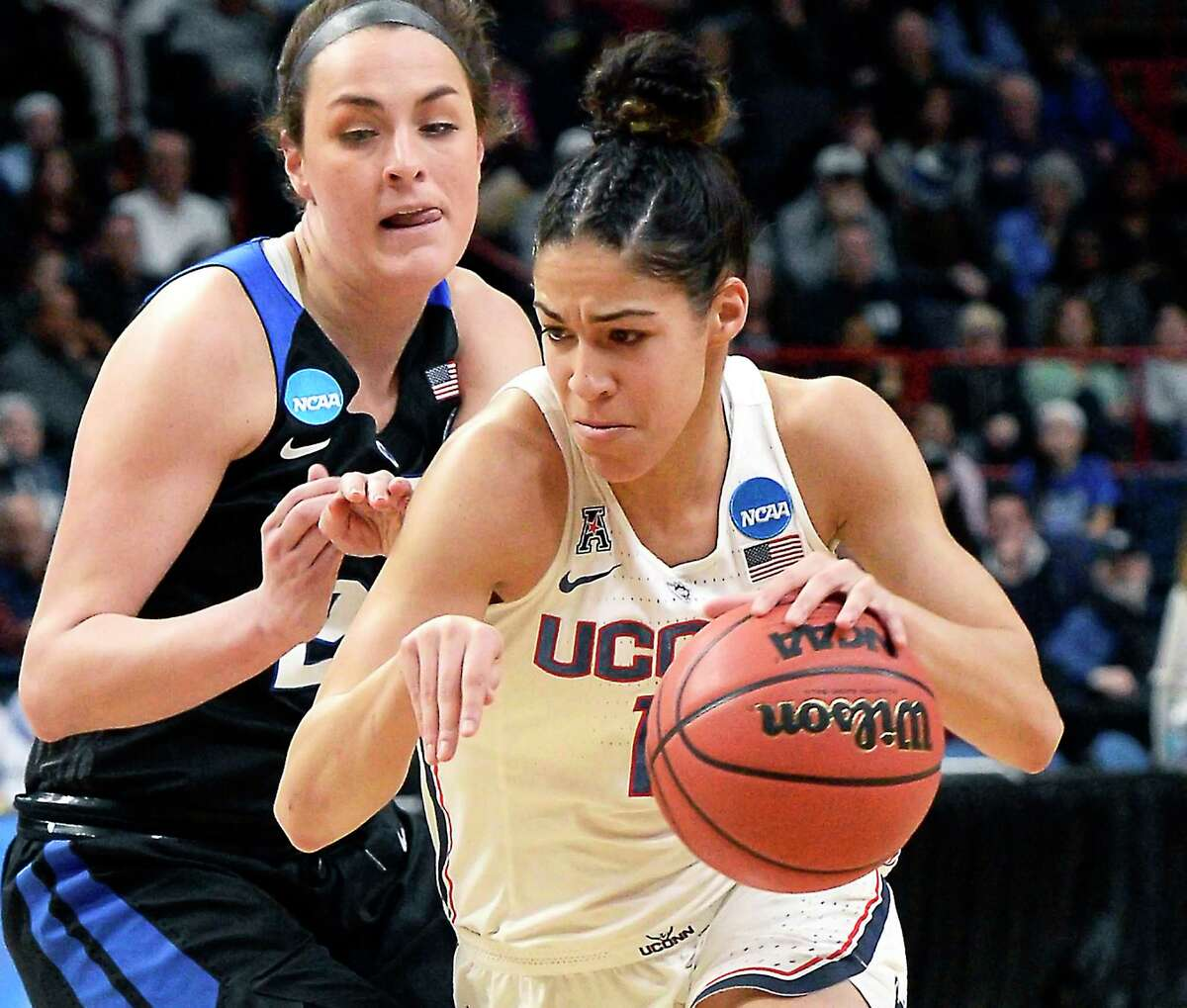 UConn's #11 Kia Nurse drives past Duke's #23 Rebecca Greenwell during their NCAA Women's Basketball Tournament regional semifinal at the Times Union Center Saturday March 24, 2018 in Albany, NY. (John Carl D'Annibale/Times Union)