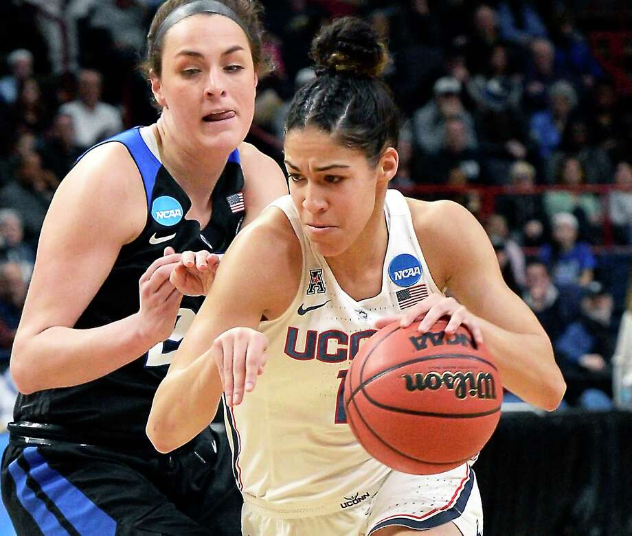 UConn's #11 Kia Nurse drives past Duke's #23 Rebecca Greenwell during their NCAA Women's Basketball Tournament regional semifinal at the Times Union Center Saturday March 24, 2018 in Albany, NY.  (John Carl D'Annibale/Times Union) Photo: John Carl D'Annibale / 20043277A