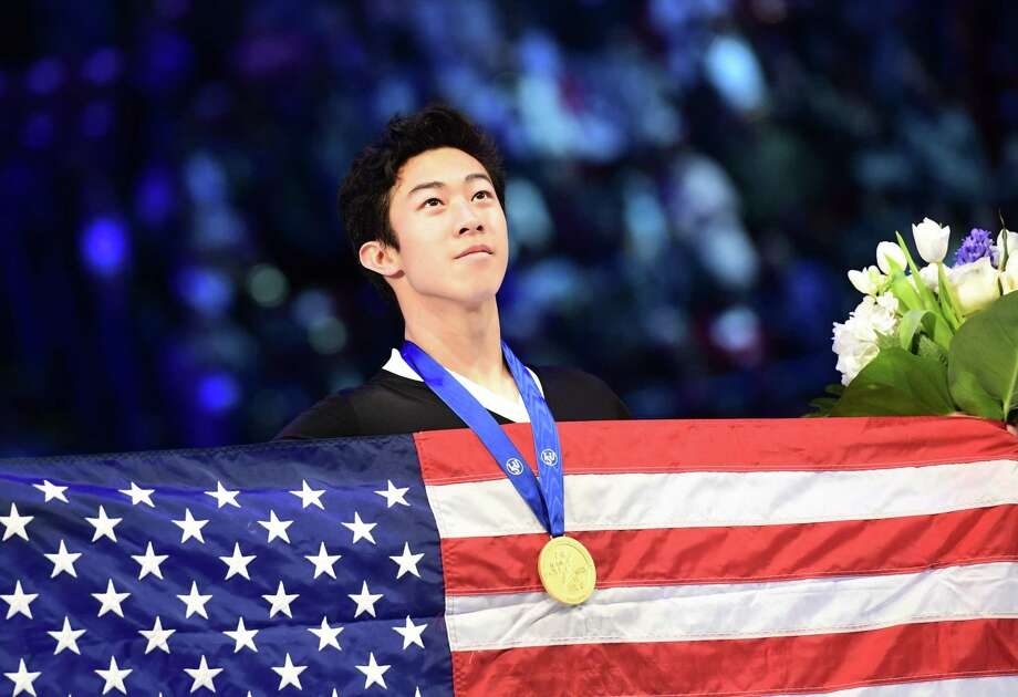 Gold medallist US Nathan Chen poses on the podium of the Men-Free Skate program at the Milan World Figure Skating Championship 2018 on March 24, 2018. / AFP PHOTO / MIGUEL MEDINAMIGUEL MEDINA/AFP/Getty Images Photo: MIGUEL MEDINA / AFP or licensors
