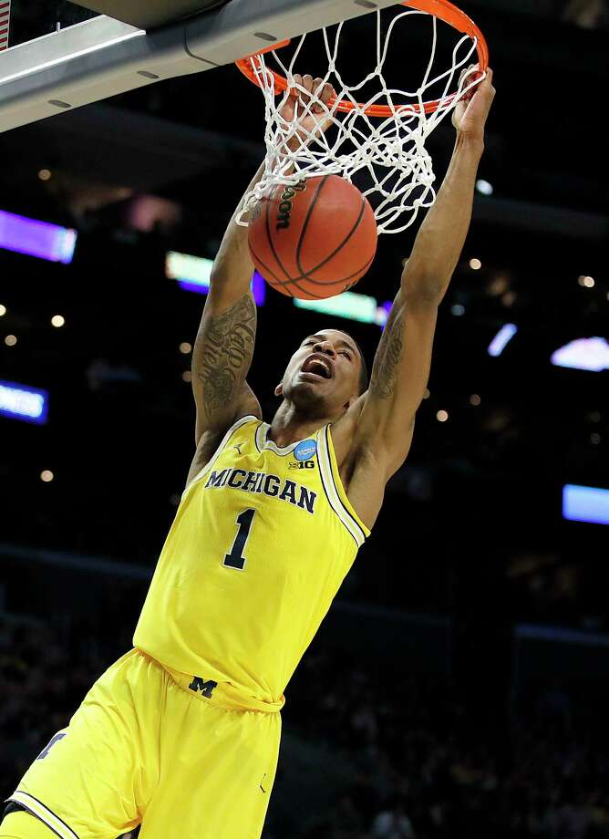 Michigan guard Charles Matthews dunks against Florida State during the first half of an NCAA men's college basketball tournament regional final Saturday, March 24, 2018, in Los Angeles. (AP Photo/Jae Hong) Photo: Jae Hong / Copyright Peter Joneleit All rights reserved