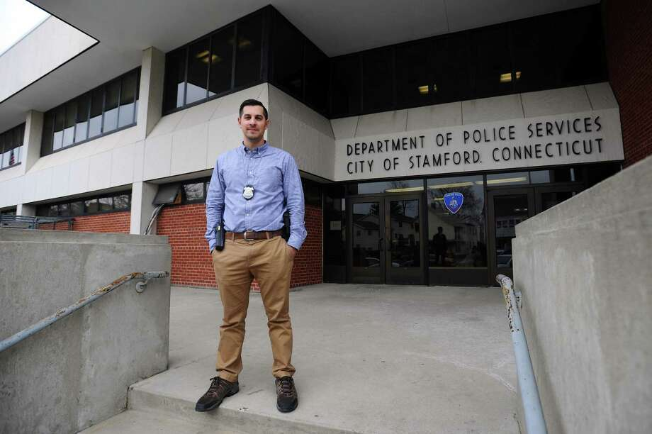 Investigator Michael Stempien, one of two officers named Stamford Officer of the Year, poses for a photo outside the Stamford police headquarters on Bedford St. in Stamford, Conn. on Tuesday, March 20, 2018. Photo: Michael Cummo / Hearst Connecticut Media / Stamford Advocate