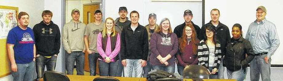 WIU graduates Scott and Kyle Lake recently visit with students in a nutrient management class taught by WIU School of Agriculture associate professor Joel Gruver.