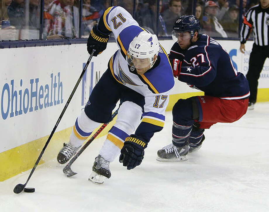 The Blues' Jaden Schwartz (left) carries the puck past the Blue Jackets' Ryan Murray during the third period Saturday night in Columbus, Ohio. The Blues won 2-1. Photo: Associated Press
