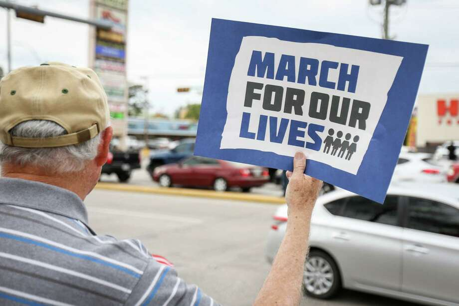 A protestor holds a sign during the March for Our Lives protest on Saturday, March 24, 2018, on Sawdust Road in Spring. Photo: Michael Minasi, Staff Photographer / © 2018 Houston Chronicle