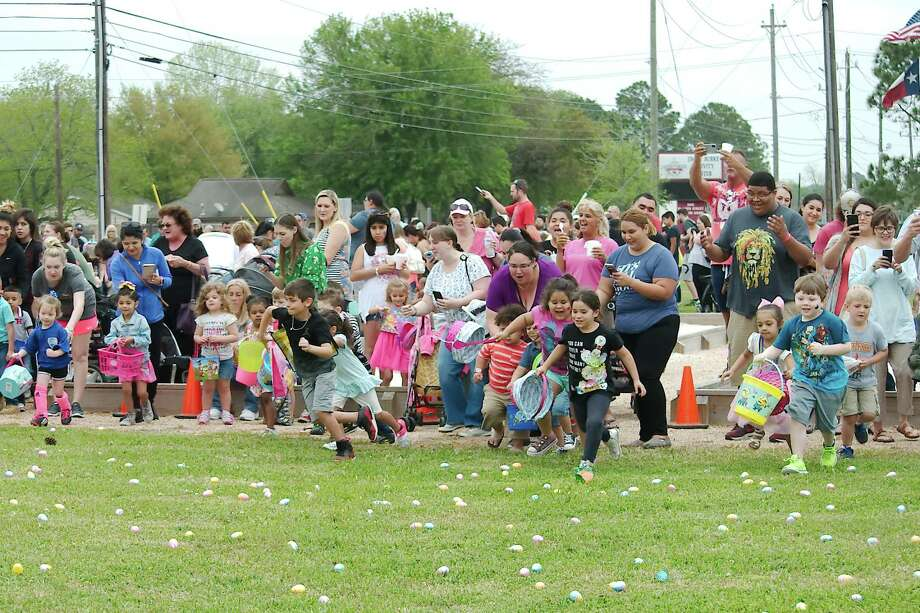 Children rush to collect eggs during the Deer Park Easter Eggstravaganza egg hunt on March 24 at the Jimmy Burke Activity Center. Photo: Kirk Sides / © 2018 Kirk Sides / Houston Chronicle