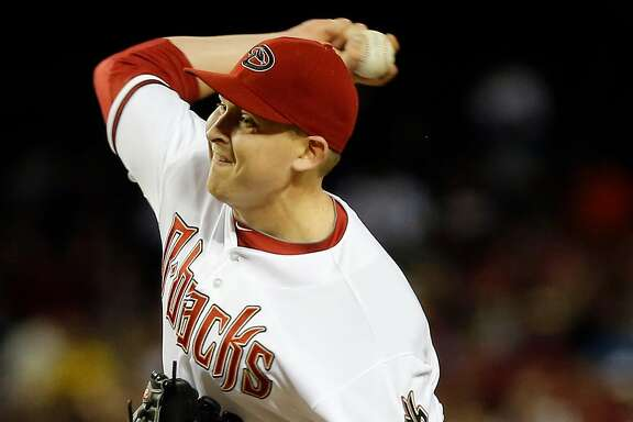 Arizona Diamondbacks pitcher Trevor Cahill delivers a pitch against the San Francisco Giants during the seventh inning of a baseball game, Tuesday, April 30, 2013, in Phoenix. (AP Photo/Matt York)