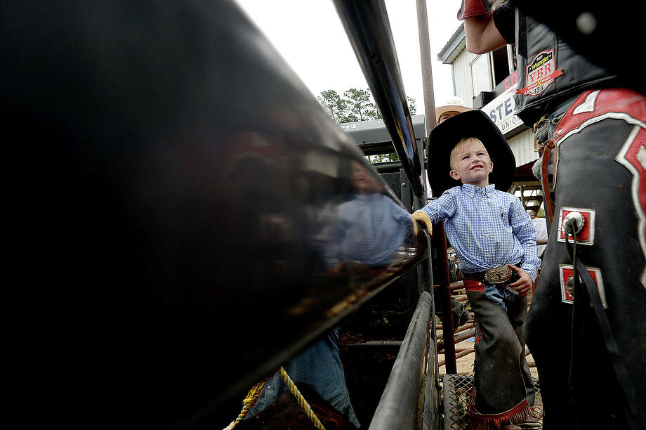 Rody Hussey, 3, of Buna watches as a senior bull rider preps for his ride at the Gulf Coast Youth Bull Riders Association rodeo event held Saturday at the Buna Bridle Club Arena. The success of Southeast Texas professional riders Cody Teel and Cooper Davis have spurred a new generation of riders to take up the sport, with many starting as young as 4 years old. Photo taken Saturday, March 24, 2018 Kim Brent/The Enterprise Photo: Kim Brent / BEN
