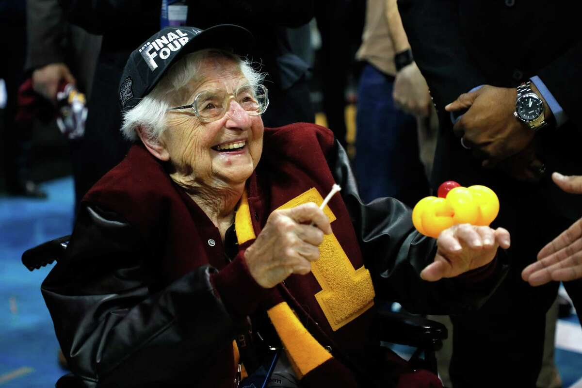 ATLANTA, GA - MARCH 24: Sister Jean Dolores Schmidt celebrates with the Loyola Ramblers after defeating the Kansas State Wildcats during the 2018 NCAA Men's Basketball Tournament South Regional at Philips Arena on March 24, 2018 in Atlanta, Georgia. Loyola defeated Kansas State 78-62.