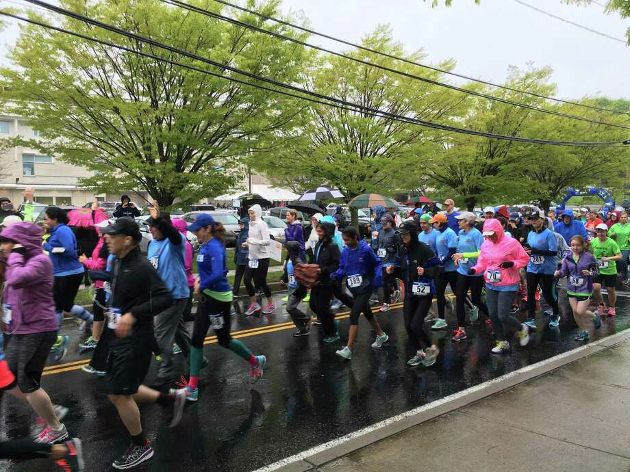 """Runners, walkers, volunteers and interested sponsors are invited to participate  in Milford Hospital's 22nd Annual Mother's Day """"Live Well"""" race on Sunday, May  13. The 5K Run / Walk is presented by Oncology Hematology Care of Connecticut in  conjunction with """"Live Well"""" community partners. Pictured: The 2016 'Live Well' race. Photo: Contributed / Milford Hospital"""