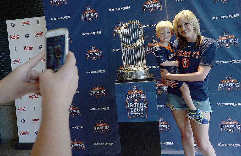 Brittni Wjhitaker and her son Bryce pose for a photo as they join the group of locals toview the Houston Astros World Series trophy during a tour stop at Buffalo Wild Wings in Beaumont Saturday. Photo taken Saturday, March 24, 2018 Kim Brent/The Enterprise Photo: Kim Brent / BEN