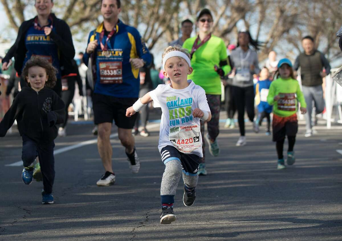 Jackson Dibirolamo, 5, finishes the Kids Fun Run on Sunday, March 25, 2018 in Oakland, CA.