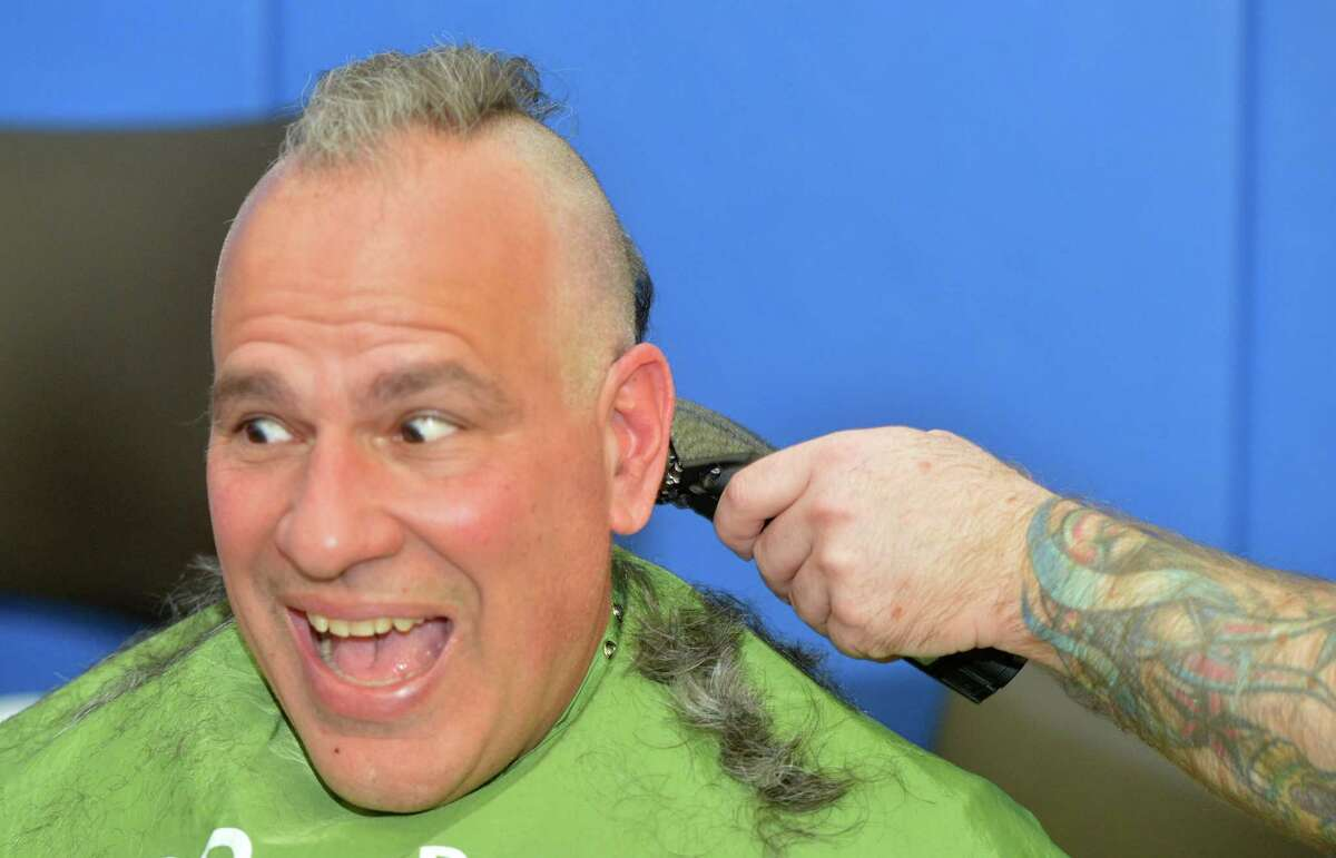 The Mohawk is short lived for Anthony Capalbo from Fairfield at the TeamBrent St. Baldrick's Foundation head shaving celebration at the Westport Family YMCA on Sunday March 25, 2018, in Westport Conn. Anthony's 20 yr-old son Charlie was diagnosed with Non-Hodgkin Lymphoma last year. This is the 14th year of the event and they have raised over four million dollars for childhood cancer research for the St. Badlrick's Foundation.