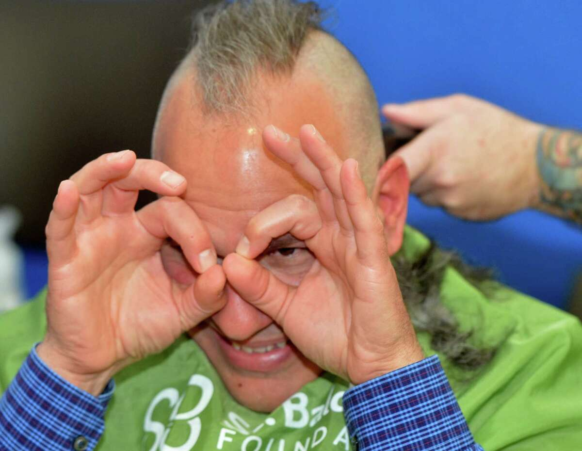 People shave their heads at The TeamBrent St. Baldrick's Foundation head shaving celebration at the Westport Family YMCA on Sunday March 25, 2018, in Westport Conn. This is the 14th year of the event and they have raised over four million dollars for childhood cancer research for the St. Badlrick's Foundation.