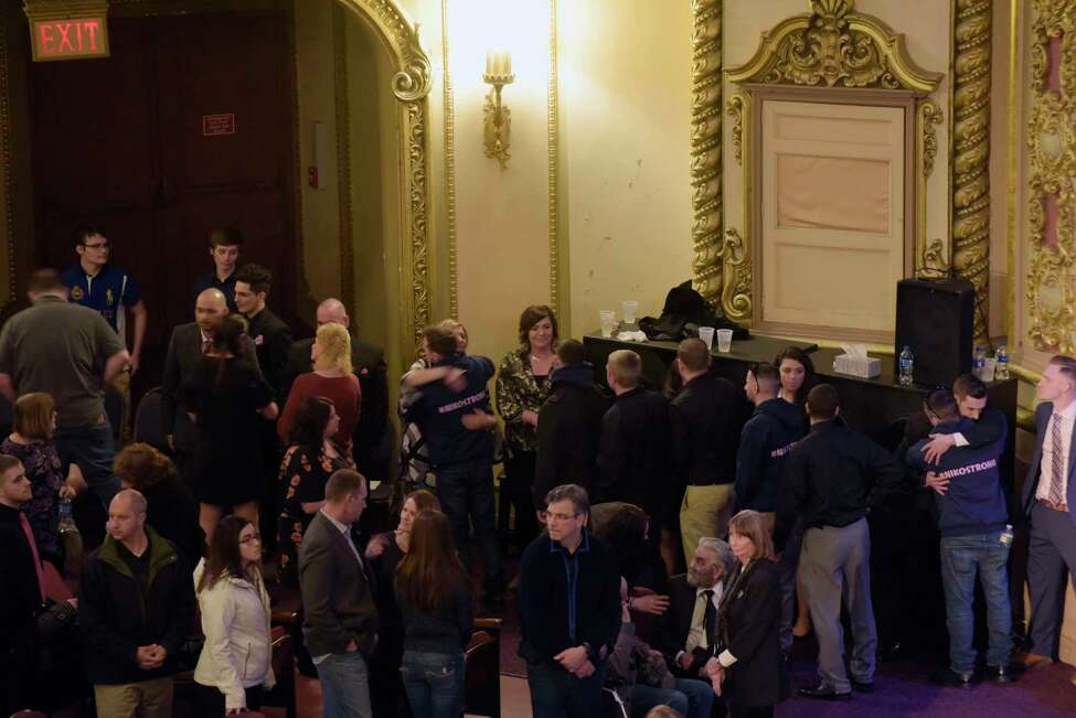 Family members greet those who gathered at the Palace Theatre during calling hours for Niko DiNovo on Sunday, March 25, 2018, in Albany, N.Y. (Paul Buckowski/Times Union)