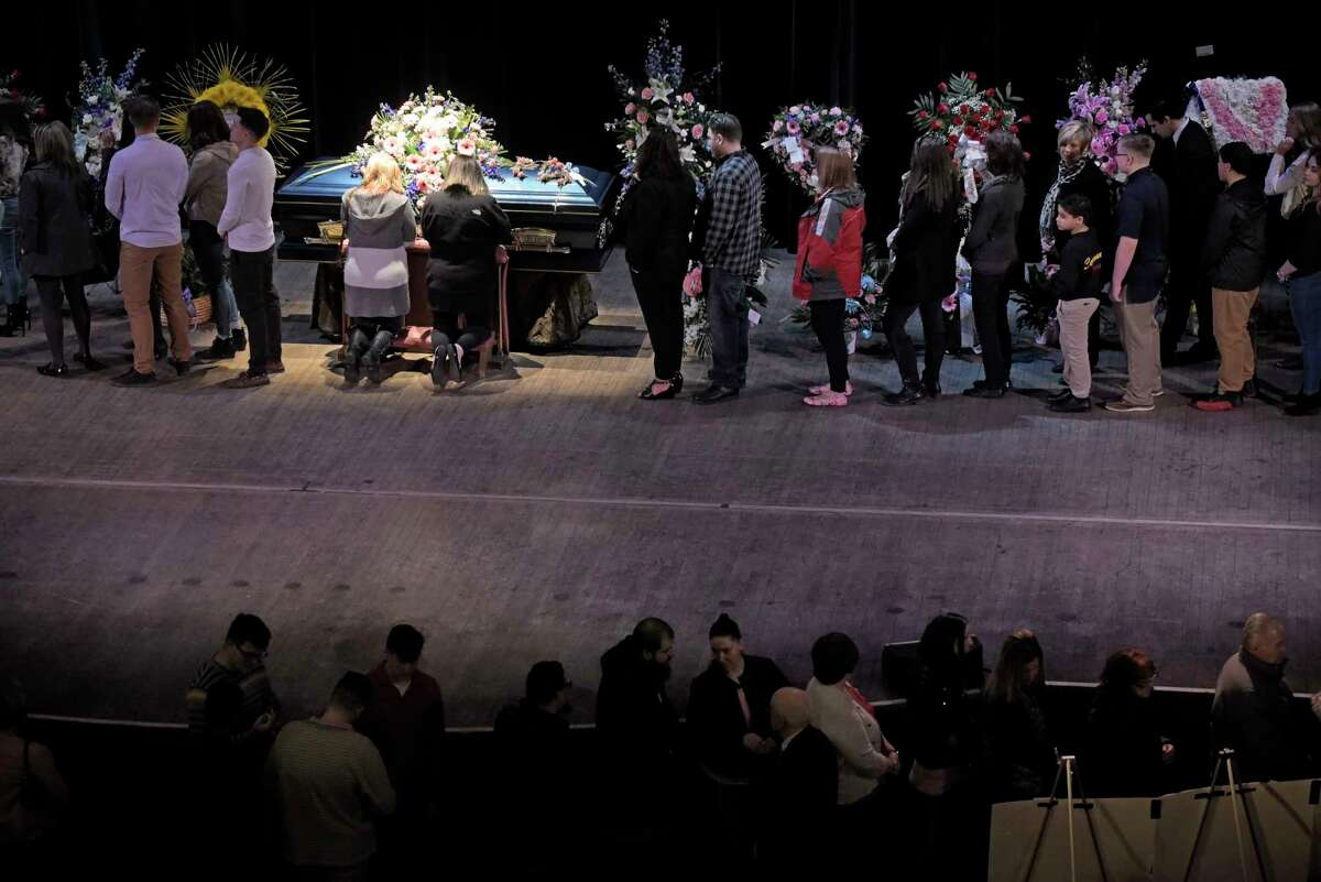 People gather at the Palace Theatre during calling hours for Niko DiNovo on Sunday, March 25, 2018, in Albany, N.Y. (Paul Buckowski/Times Union)