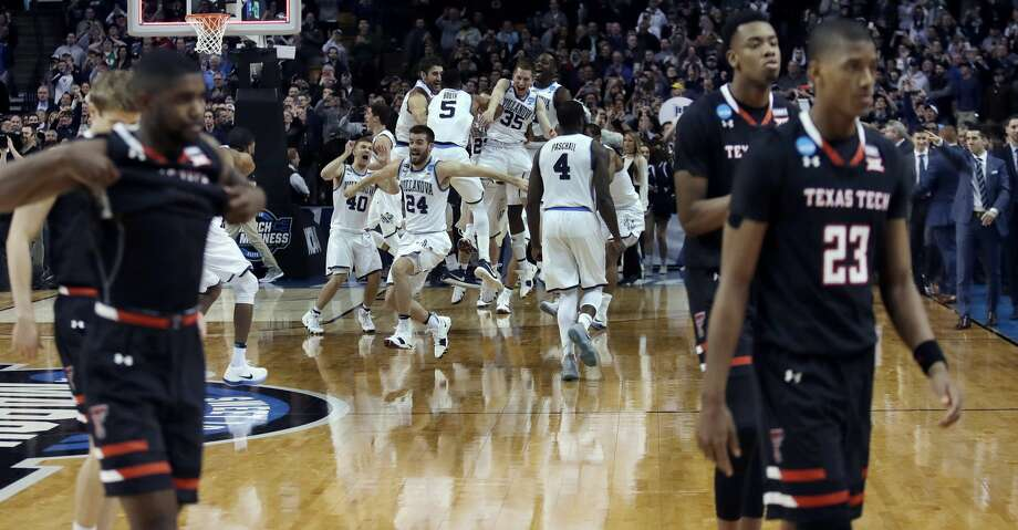 Villanova players celebrated, rear as Texas Tech's Jarrett Culver, right, leaves the court with teammates after an NCAA men's college basketball tournament regional final against Villanova, Sunday, March 25, 2018, in Boston. Villanova won 71-59 to advance to the Final Four. (AP Photo/Charles Krupa) Photo: Charles Krupa/Associated Press