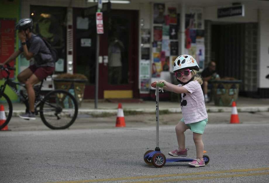 Annie Clayton, 1, rides her scooter along the 19th Street of the Heights at the Cigna Sunday Streets Houston on Sunday, March 25, 2018, in Houston. Cigna Sunday Streets Houston blocked motor vehicles from Heights Boulevard to Shepherd Drive on the 19th Street and reserved the stretch of the street for cycling, walking, dancing, socializing. ( Yi-Chin Lee / Houston Chronicle ) Photo: Yi-Chin Lee / Houston Chronicle / © 2018 Houston Chronicle