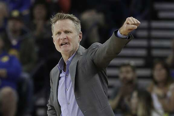 Golden State Warriors coach Steve Kerr gestures during the first half of his team's NBA basketball game against the Atlanta Hawks in Oakland, Calif., Friday, March 23, 2018. (AP Photo/Jeff Chiu)