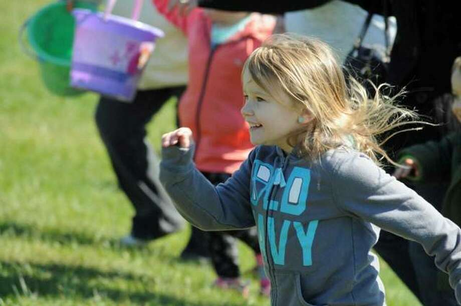 A participant bursts off the line Sunday at the start of the Easter Egg and Rock Hunt. Photo: David Blanchette | For The Telegraph