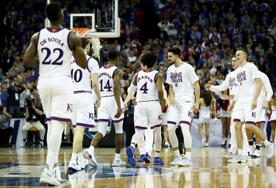 OMAHA, NE - MARCH 25:  Devonte' Graham #4 of the Kansas Jayhawks celebrates with his teammates after a basket against the Duke Blue Devils in the 2018 NCAA Men's Basketball Tournament Midwest Regional at CenturyLink Center on March 25, 2018 in Omaha, Nebraska.  (Photo by Jamie Squire/Getty Images) Photo: Jamie Squire/Getty Images