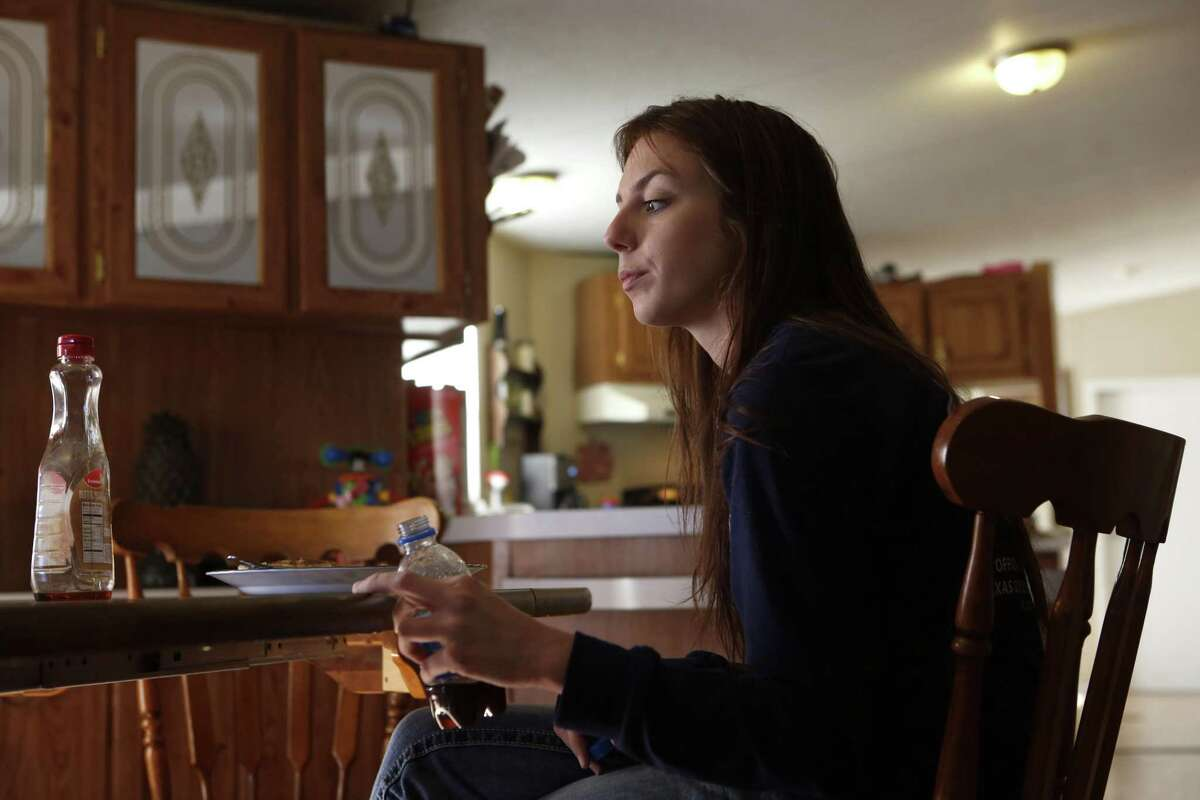 Former foster child, Alyssa Murphy, 20, one of the original plaintiffs in the state's ongoing foster care lawsuit, at her home in Canton, Texas on Sunday, February 4, 2018. Also pictured are her uncle Benjamin Hubbs, his partner, Nicole Walker, his son Adien Hubbs, and his granddaughter, Avianna Little. (photo © Lara Solt)