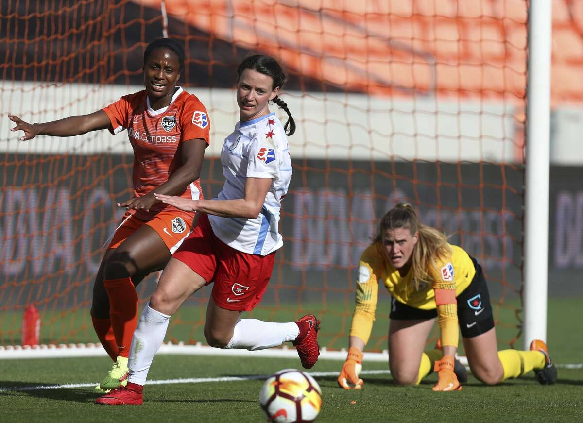 Houston Dash forward Nichelle Prince (14) and Chicago Red Stars midfielder Taylor Comeau (7) go after the ball after Chicago Red Stars goalkeeper Alyssa Naeher (1) palms the ball away from the goal during the second half of the season opener NWSL game at BBVA Stadium on Sunday, March 25, 2018, in Houston. The Houston Dash and the Chicago Red Stars tied at 1-1. ( Yi-Chin Lee / Houston Chronicle )