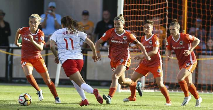 Houston Dash players go up toward Chicago Red Stars forward Sofia Huerta (11) after Huerta's free kick during the second half of the season opener NWSL game at BBVA Stadium on Sunday, March 25, 2018, in Houston. The Houston Dash and the Chicago Red Stars tied at 1-1. ( Yi-Chin Lee / Houston Chronicle )