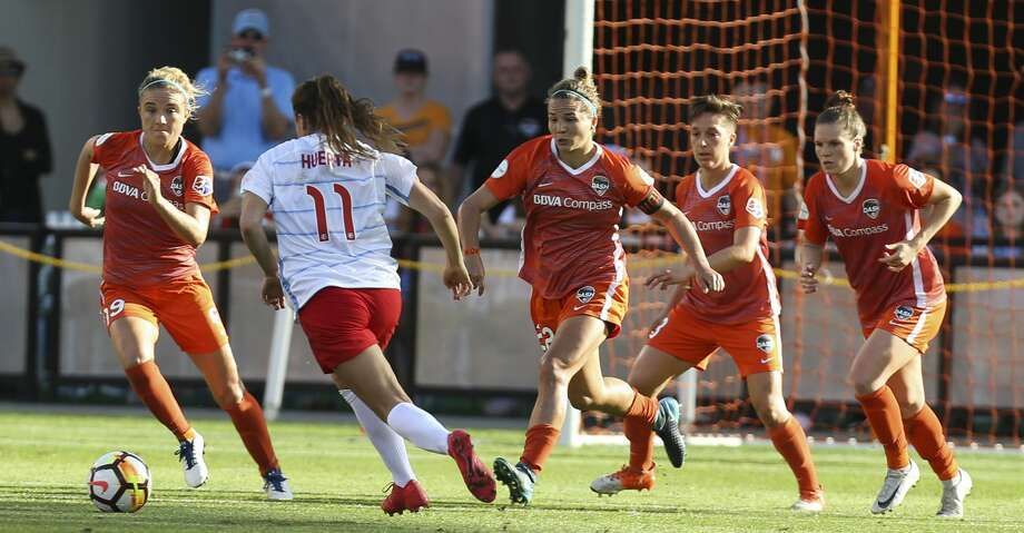Houston Dash players go up toward Chicago Red Stars forward Sofia Huerta (11) after Huerta's free kick during the second half of the season opener NWSL game at BBVA Stadium on Sunday, March 25, 2018, in Houston. The Houston Dash and the Chicago Red Stars tied at 1-1. ( Yi-Chin Lee / Houston Chronicle ) Photo: Yi-Chin Lee/Houston Chronicle