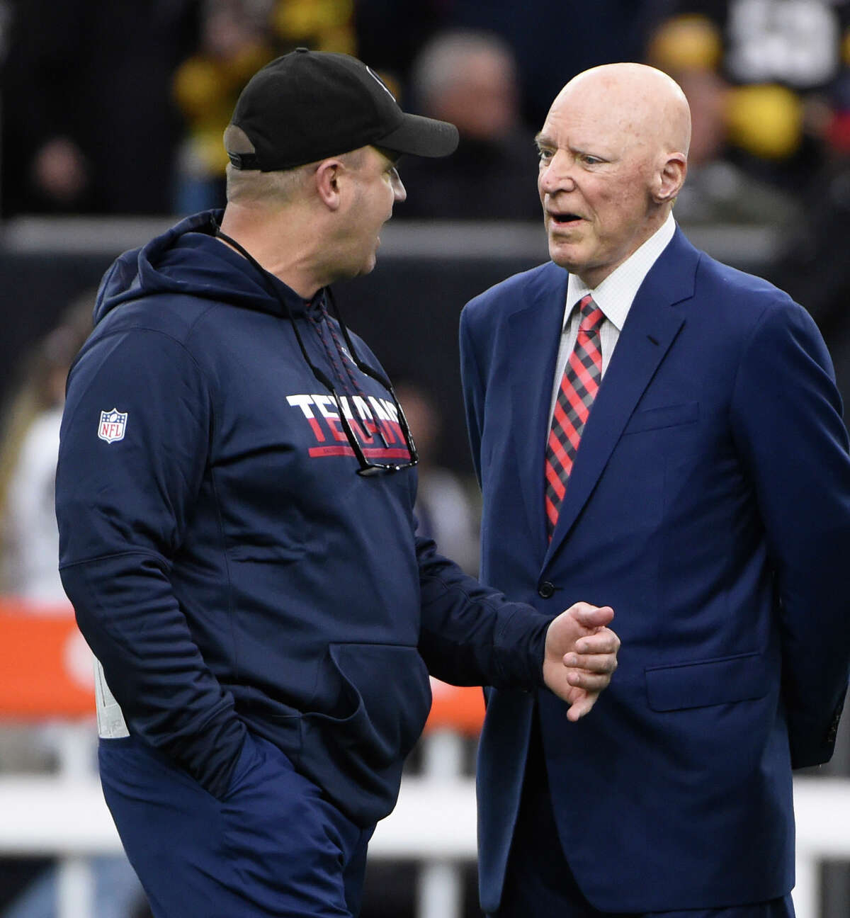 Houston Texans coach Bill O'Brien, left, talks with owner Bob McNair before an NFL football game against the Pittsburgh Steelers Monday, Dec. 25, 2017, in Houston. (AP Photo/Eric Christian Smith)