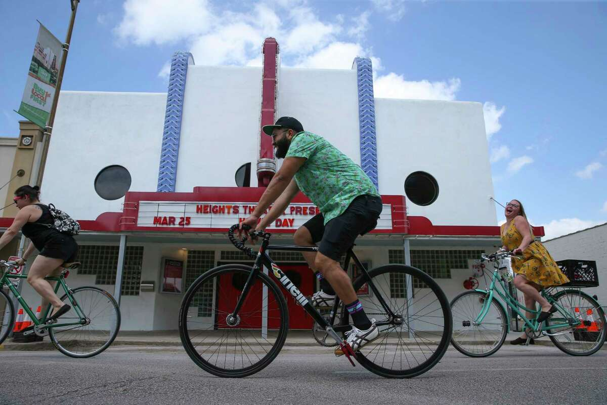 People enjoy their time at the Cigna Sunday Streets Houston on 19th Street in the Heights on March 25.