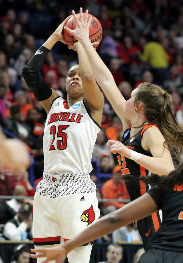 Louisville's Asia Durr shoots while pressured by Oregon State's Kat Tudor in the second half Sunday. Durr led the Cardinals with 18 points. Photo: James Crisp, FRE / FR6426 AP