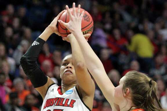 Louisville's Asia Durr shoots while pressured by Oregon State's Kat Tudor in the second half Sunday. Durr led the Cardinals with 18 points.