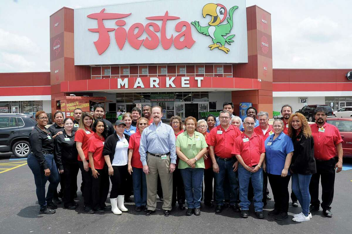 Michael D. Byars, president and CEO of Fiesta Mart, with the store team at the Fiesta Mart at 12355 Main Wednesday May 31, 2017. (Dave Rossman Photo)