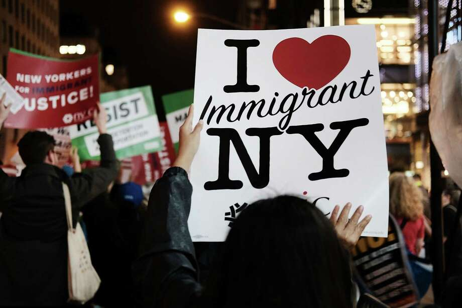 "NEW YORK, NY - NOVEMBER 06:  Members of the New York Immigration Coalition, recent immigrants and activists rally outside of Trump Tower to announce ""Dream for Our New York"", which looks to push for the Development, Relief, and Education for Alien Minors (DREAM) Act on November 6, 2017 in New York City. Last Thursday, Rep. Ileana Ros-Lehtinen (R-FL) called for a vote on legislation known as the DREAM Act to grant work permits and a path to citizenship for young immigrants brought to the U.S. illegally as children.  (Photo by Spencer Platt/Getty Images) ORG XMIT: 775071257 Photo: Spencer Platt / 2017 Getty Images"