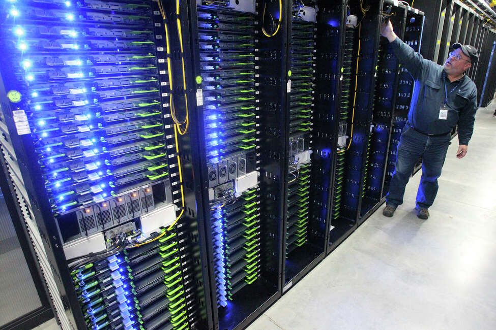 FILE - In this Oct. 15, 2013, file photo, Chuck Goolsbee, site director for Facebook's Prineville data centers, shows the computer servers that store users' photos and other data, at the Facebook site in Prineville, Ore. Facebook frequently defends its data collection and sharing activities by noting that it's adhering to a privacy policy it shares with users. (Andy Tullis/The Bulletin via AP, File)