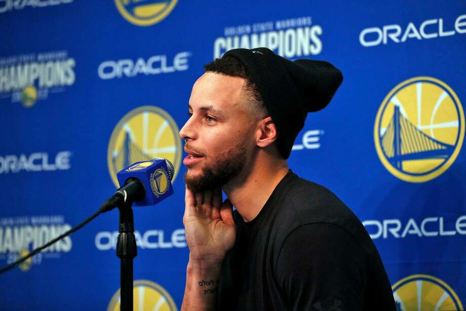 Stephen Curry (30) talks about his injury during a press conference before the Golden State Warriors played the Utah Jazz at Oracle Arena in Oakland, Calif., on Sunday, March 25, 2018. Photo: Carlos Avila Gonzalez, The Chronicle