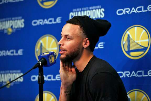 Stephen Curry (30) talks about his injury during a press conference before the Golden State Warriors played the Utah Jazz at Oracle Arena in Oakland, Calif., on Sunday, March 25, 2018.
