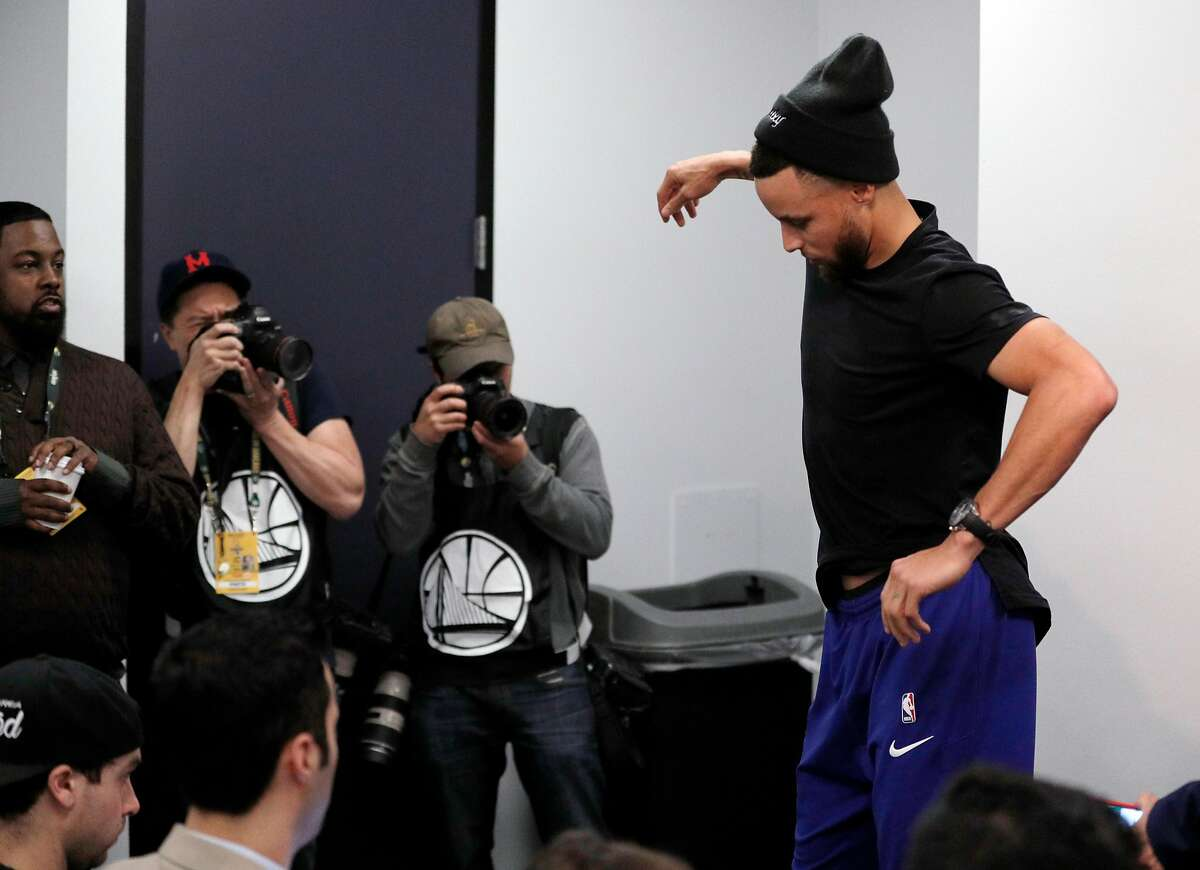 Stephen Curry (30) carefully steps off the platform after a press conference before the Golden State Warriors played the Utah Jazz at Oracle Arena in Oakland, Calif., on Sunday, March 25, 2018.