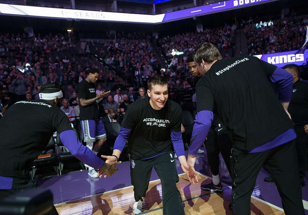 """Sacramento Kings guard Bogdan Bogdanovic (8) and teammates wear T-shirts bearing the name of Stephon Clark during a game at Golden 1 Center on Sunday March 25, 2018 in Sacramento, Calif. The Kings and Celtics wore shirts bearing the name of the unarmed man, Stephon Clark, who was killed by Sacramento police. The black warm-up shirts have """"Accountability. We are One"""" on the front and """"Stephon Clark"""" on the back. (Paul Kitagaki Jr./Sacramento Bee/TNS)"""