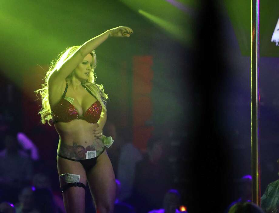 POMPANO BEACH, FL - MARCH 09:  The actress Stephanie Clifford, who uses the stage name Stormy Daniels, performs at the Solid Gold Fort Lauderdale strip club on March 9, 2018 in Pompano Beach, Florida. Stephanie Clifford who claims to have had an affair with President Trump has filed a suit against him in an attempt to nullify a nondisclosure deal with Trump attorney Michael Cohen days before Trump's 2016 presidential victory.  (Photo by Joe Raedle/Getty Images) Photo: Joe Raedle / 2018 Getty Images
