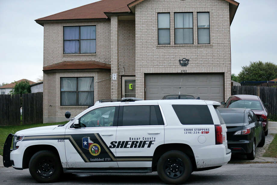 A Bexar County Sheriff vehicle is parked in front of a home in the 8900 block of Twincreek Farm, Sunday March 25, 2018, after a 4-year-old boy was attacked by the family dog and later died. Photo: Edward A. Ornelas, San Antonio Express-News / © 2018 San Antonio Express-News