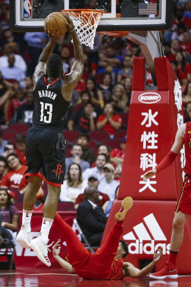 Houston Rockets guard James Harden (13) takes a shot after being called for an offensive foul as the Houston Rockets take on the Atlanta Hawks at the Toyota Center Sunday, March 25, 2018 in Houston. (Michael Ciaglo / Houston Chronicle) Photo: Michael Ciaglo/Houston Chronicle