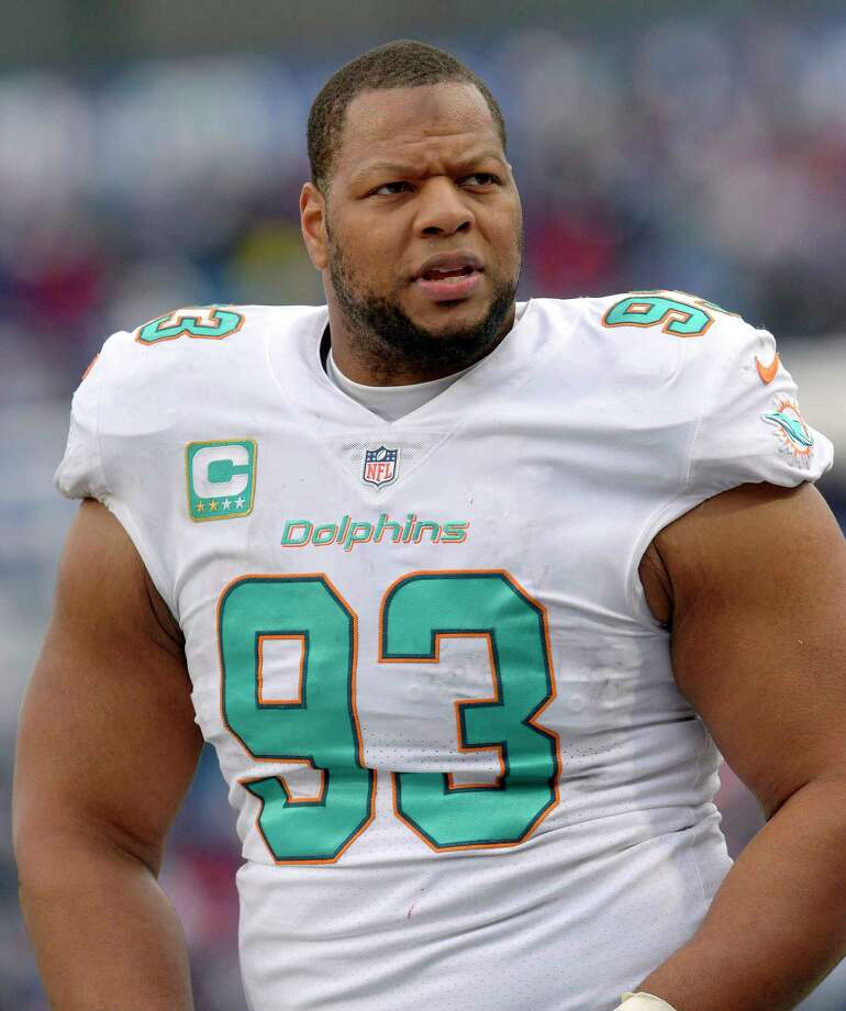FILE - In this Dec. 17, 2017, file photo, Miami Dolphins defensive tackle Ndamukong Suh (93) looks on from the sideline during the first half of an NFL football game against the Buffalo Bills, in Orchard Park, N.Y. The Miami Dolphins appear ready to move on without their defensive anchor. Miami is discussing releasing five-time Pro Bowl tackle Ndamukong Suh when the NFL's new year begins Wednesday, a person familiar with the situation said Monday, March 12, 2018. The person said nothing has been finalized, and confirmed the conversations to The Associated Press on condition of anonymity because the Dolphins have not commented. (AP Photo/Adrian Kraus, File) Photo: Adrian Kraus / FR171451 AP