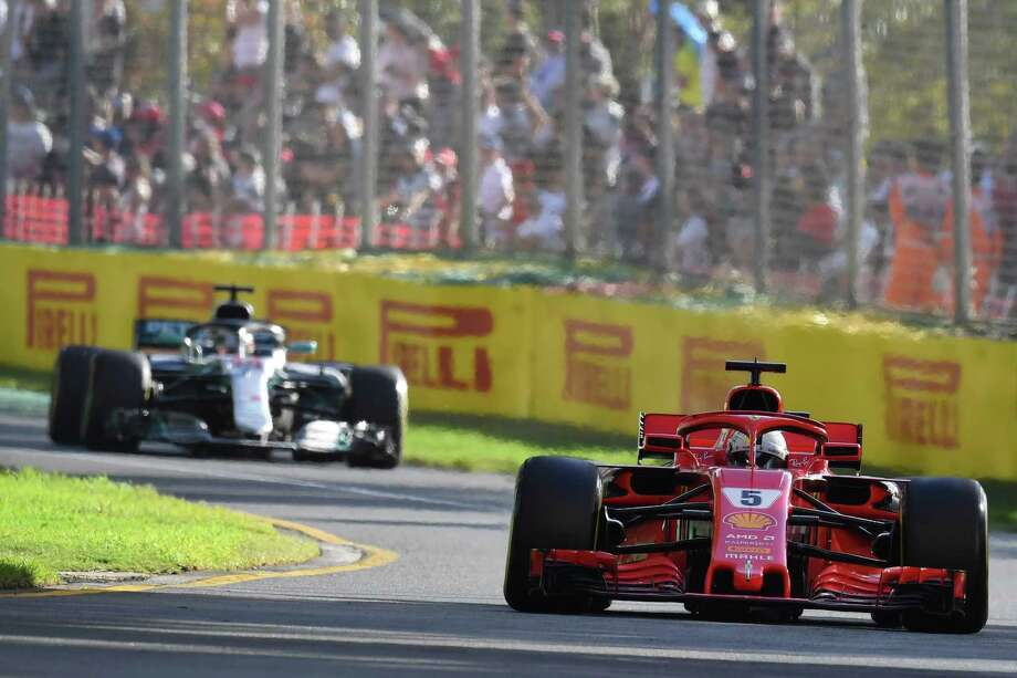 Ferrari's German driver Sebastian Vettel (R) leads Mercedes' British driver Lewis Hamilton during the Formula One Australian Grand Prix in Melbourne on March 25, 2018. / AFP PHOTO / Paul Crock / -- IMAGE RESTRICTED TO EDITORIAL USE - STRICTLY NO COMMERCIAL USE --PAUL CROCK/AFP/Getty Images Photo: PAUL CROCK / AFP or licensors