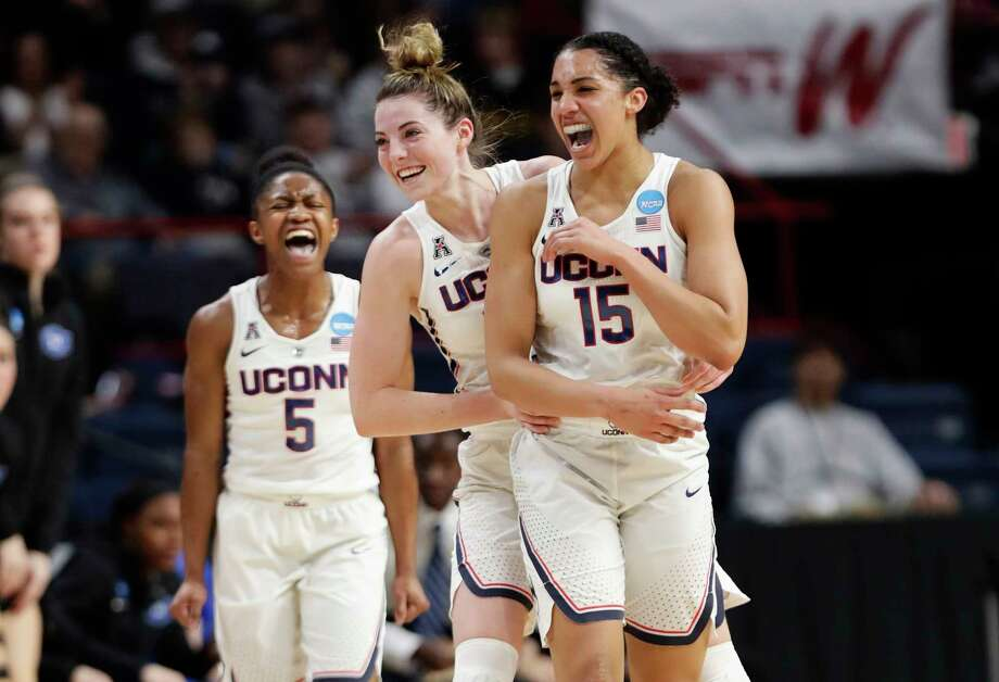 Connecticut's Crystal Dangerfield (5) and Katie Lou Samuelson (33) celebrate a 3-point basket by Gabby Williams (15) during the first half in a regional semifinal against Duke at the NCAA women's college basketball tournament Saturday, March 24, 2018, in Albany, N.Y. (AP Photo/Frank Franklin II) Photo: Frank Franklin II / Copyright 2018 The Associated Press. All rights reserved.