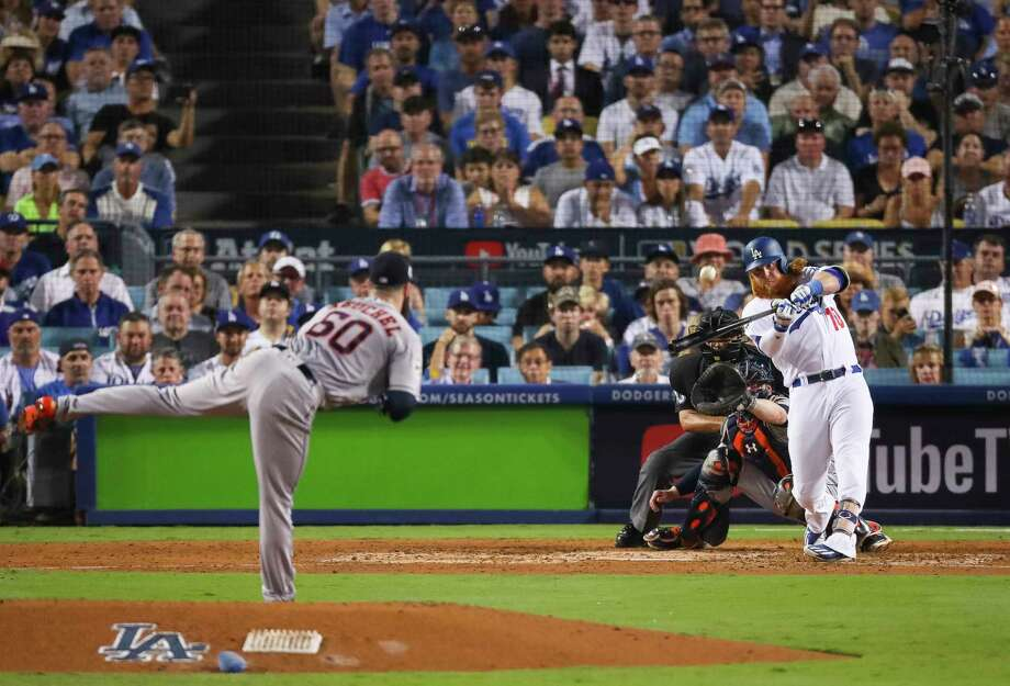 Los Angeles Dodgers third baseman Justin Turner (10) hits a two-run home run off of Houston Astros starting pitcher Dallas Keuchel (60) during the sixth inning of Game 1 of the World Series at Dodger Stadium on Tuesday, Oct. 24, 2017, in Los Angeles. ( Michael Ciaglo / Houston Chronicle ) Photo: Michael Ciaglo, Houston Chronicle / © 2017 Houston Chronicle