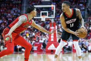 Houston Rockets guard Gerald Green (14) looks to make a move around Atlanta Hawks guard Damion Lee (8) during the second half as the Houston Rockets take on the Atlanta Hawks at the Toyota Center Sunday, March 25, 2018 in Houston.