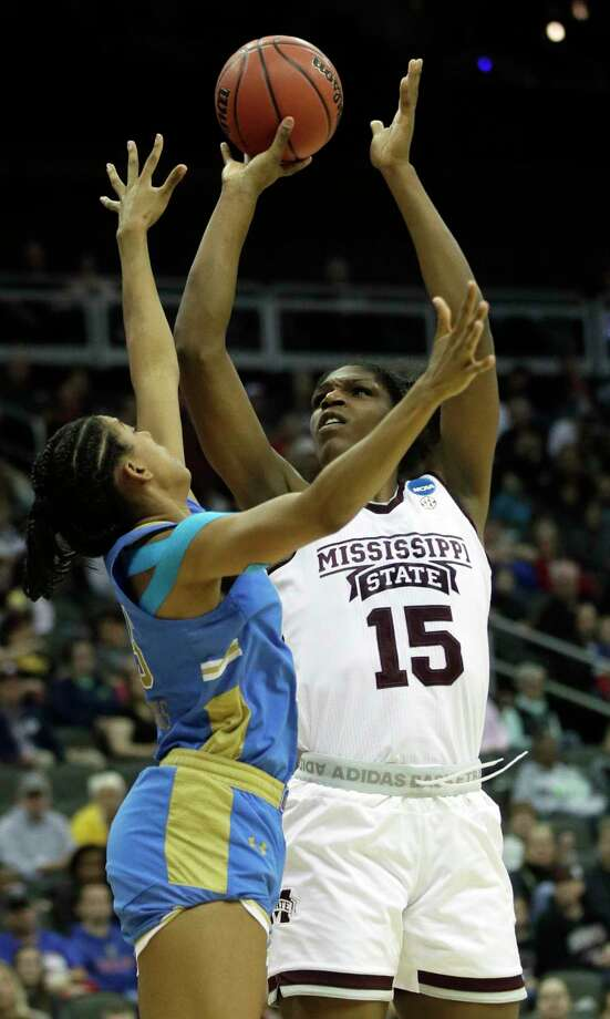 Mississippi State center Teaira McCowan (15) shoots over UCLA forward Monique Billings (25) during the second half of a women's NCAA college basketball tournament regional final game, Sunday, March 25, 2018, in Kansas City, Mo. (AP Photo/Orlin Wagner) Photo: Orlin Wagner / Copyright 2018 The Associated Press. All rights reserved.