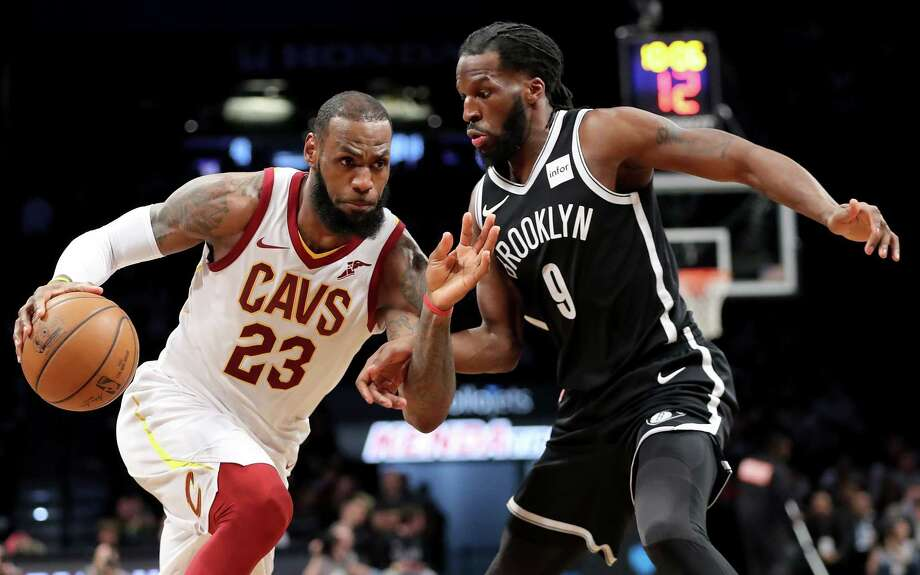 NEW YORK, NY - MARCH 25: LeBron James #23 of the Cleveland Cavaliers dribbles to the basket against DeMarre Carroll #9 of the Brooklyn Nets in the third quarter during their game at Barclays Center on March 25, 2018 in the Brooklyn borough of New York City. NOTE TO USER: User expressly acknowledges and agrees that, by downloading and or using this photograph, User is consenting to the terms and conditions of the Getty Images License Agreement.  (Photo by Abbie Parr/Getty Images) Photo: Abbie Parr / 2018 Getty Images