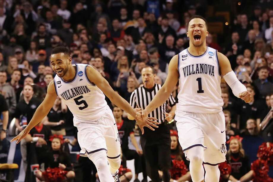 BOSTON, MA - MARCH 25:  Phil Booth #5 and Jalen Brunson #1 of the Villanova Wildcats celebrate defeating the Texas Tech Red Raiders 71-59 in the 2018 NCAA Men's Basketball Tournament East Regional to advance to the 2018 Final Four at TD Garden on March 25, 2018 in Boston, Massachusetts.  (Photo by Elsa/Getty Images) Photo: Elsa / 2018 Getty Images
